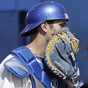 Kansas catcher Jaxx Groshans, left, visits with starting pitcher Taylor Turski in the early innings of the Jayhawks' home game against Texas Tech, Saturday, April 7, 2018, at Hoglund Ballpark. KU fell to Texas Tech, 10-0.