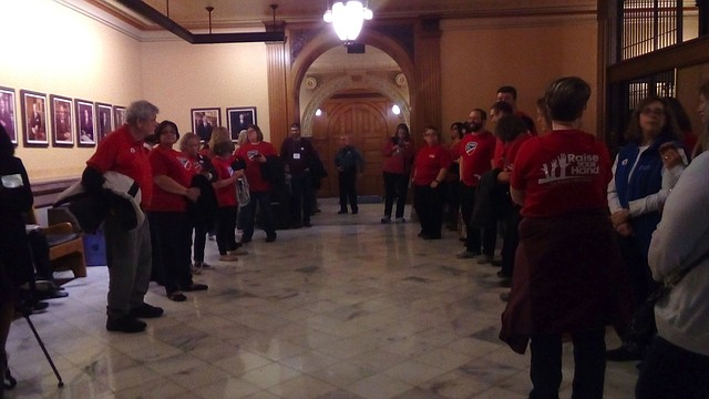 Teachers gather outside the Senate chamber at the Kansas Statehouse to urge lawmakers to pass a school finance bill Saturday, April 7, 2018.