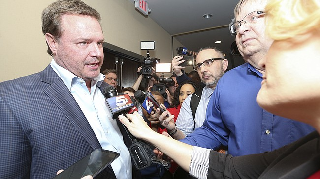 Kansas head coach Bill Self takes questions from media members about recent updates involving Kansas in the college basketball bribery case following Kansas basketball banquet on Tuesday, April 10, 2018 at the DoubleTree Hotel in Lawrence.