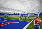 This rendering shows an early concept for a new University of Kansas indoor football practice facility that will be built west of Memorial Stadium.