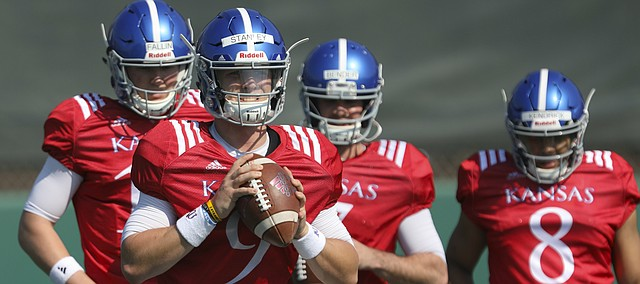 Kansas quarterback Carter Stanley clutches the ball as he prepares to throw during practice on Tuesday, April 10, 2018.