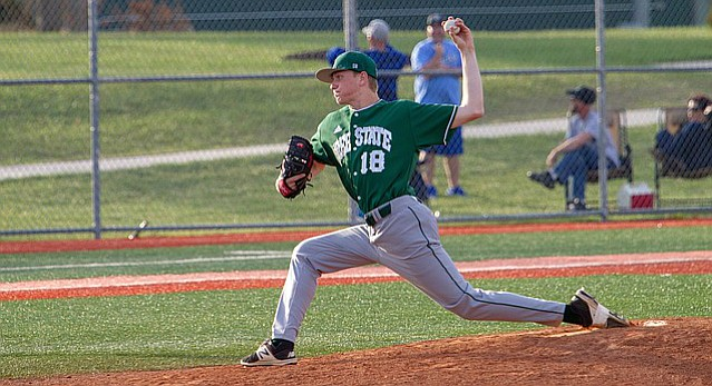 Free State pitcher Ethan Bradford (18) winds up for the pitch on Thursday, April 12, 2018. Free State beat Gardner Edgerton, 3-1.