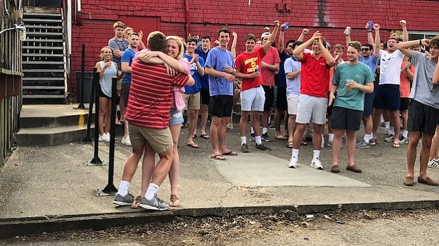 Members of the Crimson and Blue coalition celebrate after Noah Ries (front left, red) and Charles Jetty (not pictured) were announced as the next student body president and vice president, respectively, at the University of Kansas.