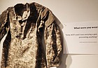 """A set of Army fatigues hangs on the wall for the """"What Were You Wearing? Survivor Art Installation"""" on display in the Kansas Union gallery on the University of Kansas campus. The display, facilitated by KU's Sexual Assault Prevention and Education Center, is back by popular demand this month after its original KU debut last fall."""
