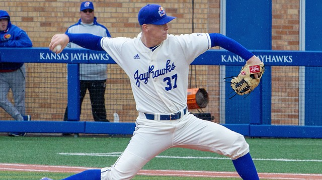 Kansas pitcher Ryan Cyr winds up for a pitch against TCU Saturday, April 14, 2018, at Hoglund Ballpark. KU fell to TCU, 13-3.