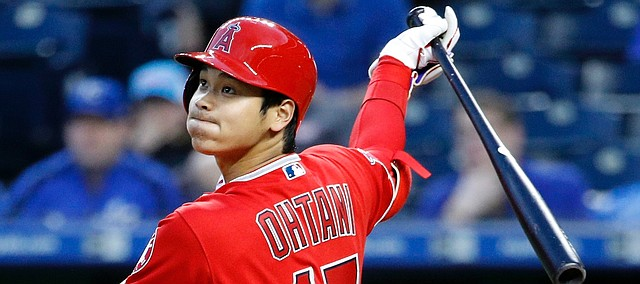 Los Angeles Angels' Shohei Ohtani hits a double during the second inning of a baseball game against the Kansas City Royals, Friday, April 13, 2018, in Kansas City, Mo. (AP Photo/Charlie Riedel)