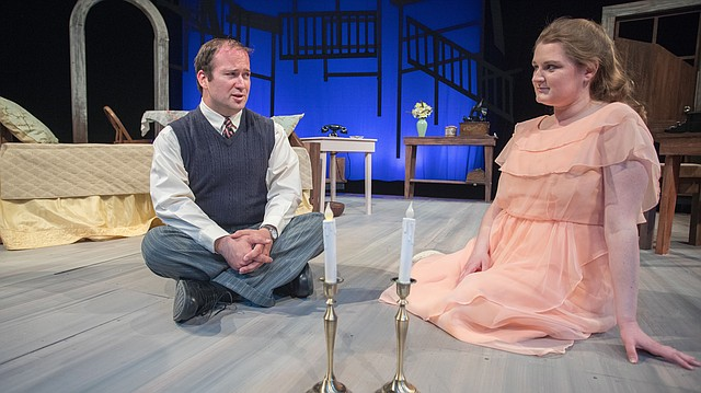 "Yosie Cardin-Ritter (as Jim O'Connor) and Nicole Putnam (as Laura Wingfield) rehearse a scene from ""The Glass Menagerie"" at Theatre Lawrence. The classic play by Tennessee Williams opens April 20."