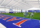 This rendering shows the interior design for a new $26 million University of Kansas indoor football practice facility.