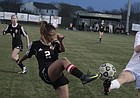 Lawrence High's Maria Duncan (2) and Free State's Kate Lawrence battle for possession in the second half of the girls soccer City Showdown, which ended in a 1-1 tie on Thursday at FSHS.