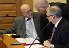 Larry Campbell, left, Kansas Gov. Jeff Colyer's budget director, confers with J.G. Scott, center, the Legislature's top fiscal analyst, and Raney Gilliland, right, the director of the Legislature's research staff, before the release of a new fiscal forecast on Friday, April 20, 2018, at the Statehouse in Topeka. The new forecast boosts projected tax collections through June 2019 by a total of $540 million. (AP Photo/John Hanna)