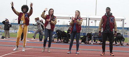 Former Jayhawks (from left to right) Diamond Dixon, Andrea Geubelle, Natalia Bartnovskaya and Kyle Clemons wave to the crowd at Rock Chalk Park after being announced as KU Athletics Hall of Fame inductees.