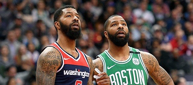 Washington Wizards forward Markieff Morris (5) stands next to his brother and Boston Celtics forward Marcus Morris (13) during the second half of an NBA basketball game Tuesday, April 10, 2018, in Washington. The Wizards won 113-101. (AP Photo/Nick Wass)