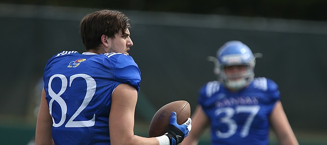 Kansas tight end James Sosinski throws the ball around with teammates during practice on Tuesday, April 17, 2018.
