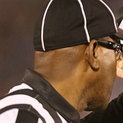 Kansas head coach David Beaty talks with an official after a targeting call was made during the fourth quarter on Saturday, Sept. 2, 2017 at Memorial Stadium. The call was eventually reversed.