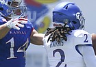 Kansas cornerback Corione Harris picks off a pass to Kansas wide receiver Kerr Johnson Jr. (14) during an open practice on Saturday, April 28, 2018 at Memorial Stadium.