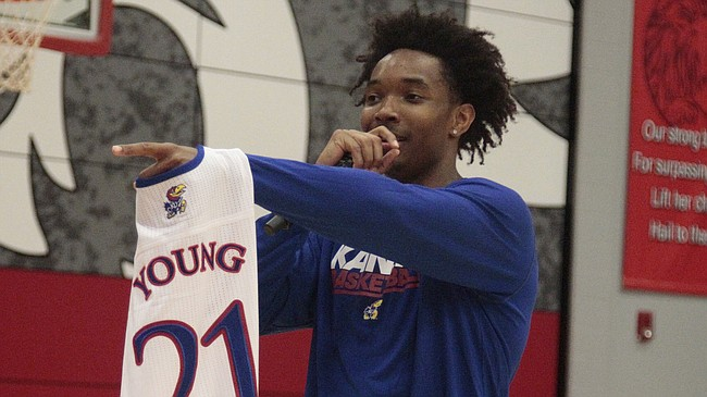 Kansas senior Devonte' Graham auctions off a Clay Young jersey during a timeout in the Kansas Barnstormers game on Saturday, April 28, 2018 at Lansing High School.