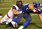 Kansas tight end Ben Johnson (84) is dragged down by Southeast Missouri linebacker Rider Garrett (42) after making a deep catch during the third quarter on Saturday, Sept. 2, 2017 at Memorial Stadium.