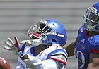 Kansas cornerback Julian Chandler (25) breaks up a pass to Kansas wide receiver Evan Fairs (19) during an open practice on Saturday, April 28, 2018 at Memorial Stadium.