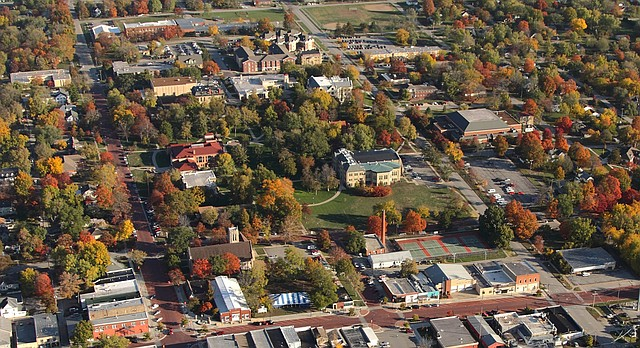 This aerial file photograph from October 2015 shows the downtown area of Baldwin City at center with the Baker University campus to the north, at top.