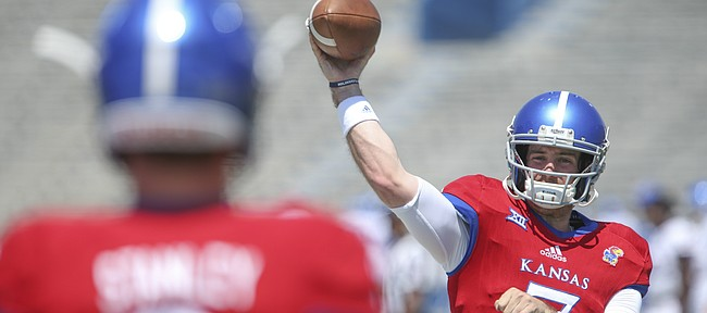 Kansas quarterback Peyton Bender (7) throws to Kansas quarterback Carter Stanley (9) during an open practice on Saturday, April 28, 2018 at Memorial Stadium.