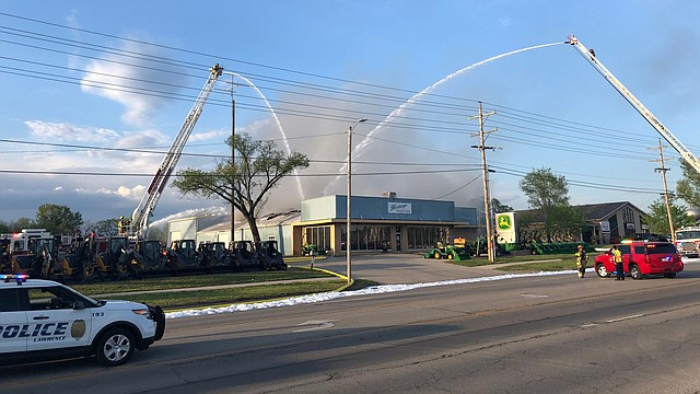 Firefighters respond to a fire at Heritage Tractor, 1110 E. 23rd St., on Saturday, May 5, 2018.