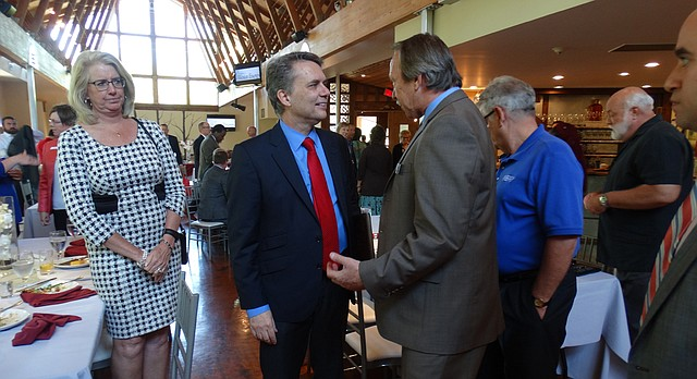 Gov. Jeff Colyer talks with members of the Lawrence chamber of commerce following a luncheon speech Monday at the Arterra Event Gallery.