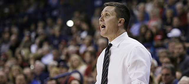 San Francisco's Head Coach Rex Walters instructs his team during the first half of an NCAA basketball game against Gonzaga on Monday, Dec., 30, 2013 in Spokane, Wash.