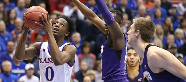 Kansas guard Marcus Garrett (0) moves in for a bucket during the first half on Tuesday, Feb. 6, 2018 at Allen Fieldhouse.