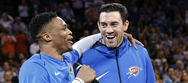 Oklahoma City Thunder guard Russell Westbrook, left, addresses the crowd with teammate Nick Collison, right, before an NBA basketball game against the Memphis Grizzlies in Oklahoma City, Wednesday, April 11, 2018. (AP Photo/Sue Ogrocki)