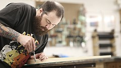 "Lawrence Arts Center artist-in-residence Michael Benedetti works on creating a frame in preparation for his show, ""The Architecture of Memory,"" which opens on May 18 at the Arts Center, 940 New Hampshire St."