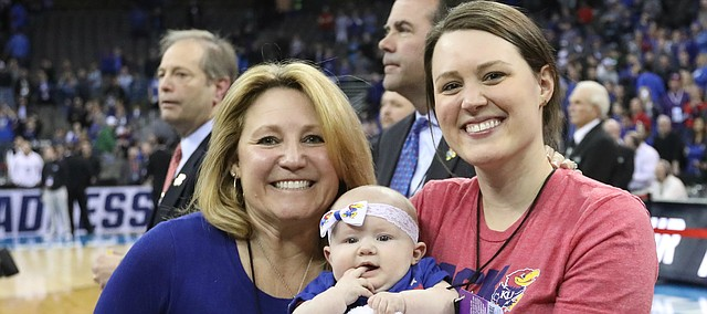 Kansas head coach Bill Self's wife Cindy, daughter Lauren and granddaughter, Ella, are pictured as the Jayhawks celebrate a trip to the Final Four following their 85-81 overtime victory over Duke on Sunday, March 25 in Omaha, Neb.