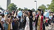 University of Kansas students walk down the hill to participate in the 146th KU Commencement ceremony Sunday, May 13, 2018 on the KU campus in Lawrence.