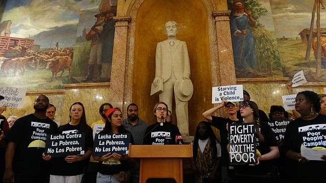 Rev. Rose Schwab, center, pastor at the Shawnee Mission Unitarian Universalist Church in Johnson County, joins several dozen demonstrators Monday, May 14, 2018 at the Statehouse to launch what they are calling a Poor People's Campaign for reforms in public welfare programs, criminal justice, health care and environmental laws.