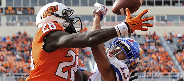 Kansas corner back Hasan Defense (13) interrupts a pass to Oklahoma St wide receiver James Washington (28) in the Oklahoma St end zone during a NCAA college football game in Stillwater, Okla., Saturday, Nov. 25, 2017.