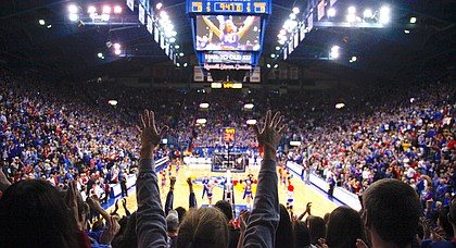 Fans raise their hands during the playing of the Alma Mater on Saturday, Dec. 15, 2012 at Allen Fieldhouse.