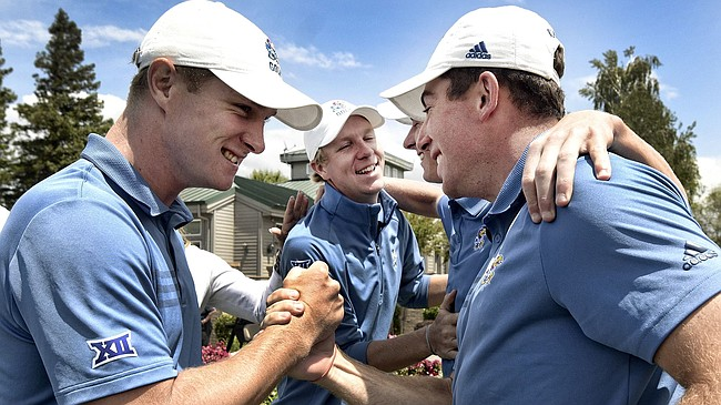 Charlie Hillier shakes Daniel Hudson's hand in the foreground and Daniel Hudson pats Harry Hillier on chest in background as Kansas golfers celebrate winning the Pacific Regional to advance to the national finals for the first time since 2000. (Photo courtesy of Kansas Athletics)