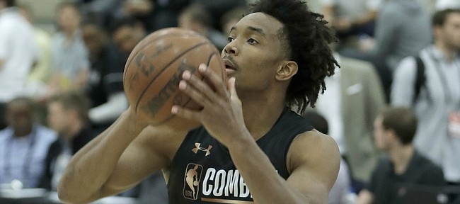 Devonte' Graham, from Kansas, participates in the NBA draft basketball combine Thursday in Chicago. (AP Photo/Charles Rex Arbogast)