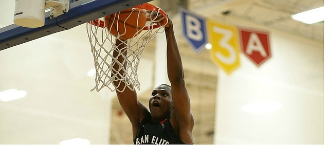 N'Faly Dante, No. 4-ranked prospect by Rivals in Class of 2020, dunks during showcase game Saturday night at KC Classic at Sports Pavilion Lawrence. (Photo by Darryl Woods/810 Varsity).