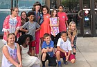 Teacher Lauren Mitchell and members of her fourth grade class at Kennedy Elementary School pose outside City Hall, 6 E. Sixth St.