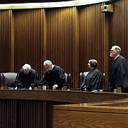 Kansas Supreme Court justices take there seats before hearing arguments in a school funding case in Topeka, Kan., Tuesday, May 22, 2018. The court is reviewing a law passed this spring by the Republican-led Legislature and signed by GOP Gov. Jeff Colyer that will phase in a $548 million education funding increase over five years. (AP Photo/Orlin Wagner, Pool)