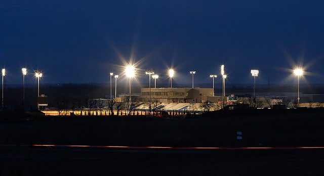 From a view looking north, the lights of the Rock Chalk Sports Park illuminate the facilities on Monday, April 7, 2014.