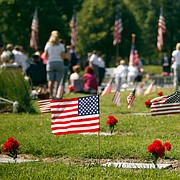 In this file photo from May 28, 2012, visitors to Oak Hill Cemetery attend a flag ceremony organized by the local American Legion post.