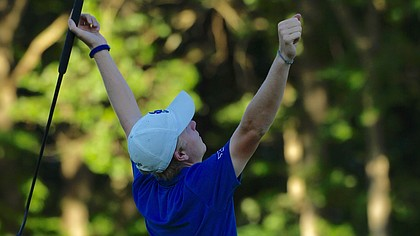 Kansas senior Daniel Sutton celebrates making a 60-foot eagle putt on No. 14 Sunday, May 27, 2018, at Karsten Creek in KU's third round of the NCAA golf championship. (Photo by Jeff Jacobsen/Kansas Athletics)