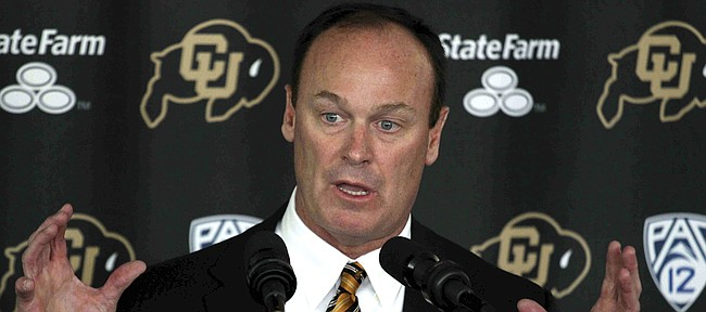 Rick George speaks during a news conference at which he was named Colorado athletic director, in Boulder, Colo., Wednesday, July 17, 2013. George has been the president of business operations for the Texas Rangers. George once served as Colorado's assistant athletic director for football operations from 1987-91. (AP Photo/Brennan Linsley)