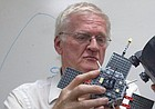In this 2013 file photo, Tom Armstrong holds a model of a satellite. Armstrong, a longtime KU physics professor and NASA researcher, died June 2, 2018.