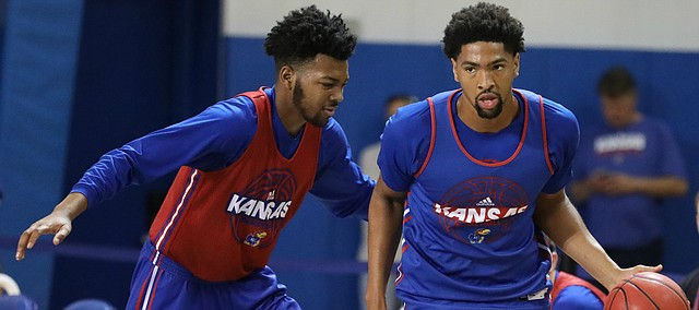 Blue Team forward Dedric Lawson (1) dribbles past Red Team forward K.J. Lawson during a scrimmage on Tuesday, June 5, 2018, at the Horejsi Athletic Center.