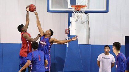 Blue Team center David McCormack blocks a shot from Red Team forward Silvio De Sousa (22) during a scrimmage on Tuesday, June 5, 2018, at the Horejsi Athletic Center.