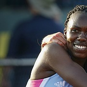 Kansas' Sharon Lokedi, left, is hugged by New Mexico's Alice Wright after Lokedi's win in the women's 10,000 meters during the second day of the NCAA Outdoor Track and Field Championships at Hayward Field on Thursday, June 7, 2018, in Eugene, Ore. Wright finished in fourth place. (Andy Nelson/The Register-Guard via AP)