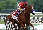Justify, with jockey Mike Smith up, crosses the finish line to win the 150th running of the Belmont Stakes horse race and the Triple Crown, Saturday, June 9, 2018, in Elmont, N.Y.