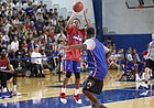 Red Team guard Charlie Moore puts up a three over Blue Team guard Elijah Johnson during a scrimmage on Wednesday, June 13, 2018, at the Horejsi Family Athletics Center.